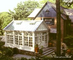 glass conservatory additions | Conservatories are not always just white and glass as evidenced by ...