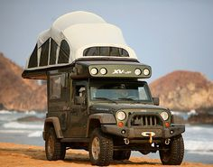 $110,000 Earth Roamer XV-JP   Jeep Rubicon with 9 feet of standing space, queen bed, toilet, 100L water tank, shower, sink, cooking and solar powered fridge.