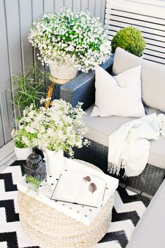 Make a small space feel warmer and bigger by laying down the largest outdoor area rug your environment can accomodate. On a budget? Pick up a few smaller versions, which tend to be much cheaper, to layer on top of each other for a collected and eclectic look.