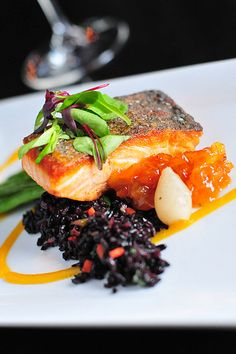 Pan Seared Scottish Salmon with forbidden wild rice, haricot verts, pearl onion, pineapple kumquat chutney.