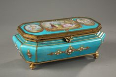 French late 19th century light blue porcelain casket with bronze mounts resting on four feet. The lid is decorated with a central scene showing a man playing a musical instrument to his beloved...