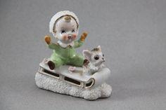 Vintage Napco figurine of boy on sled