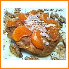 Cinnamon pancake topped with fresh mandarin, coconut flakes, chia seeds and organic maple syrup with raw activated walnuts on the side. Paleo, gluten, dairy and sugar free using coconut flour, buckwheat flour, filtered water,  eggs, organic cinnamon and a