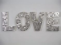 Glue silver coins onto mounted Styrofoam letters.