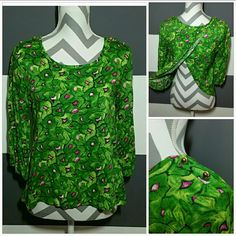 """""""Green with Envy"""" semi open back top NWOT Brand new no tags  Springtime top!! Make them green with envy in this fun top. Green and pink pattern. The back is semi opened as seen in pics. Gold button details at shoulders.  Elastic at ends of sleeves 100% rayon Length approx 22"""" The Vintage Shop Tops"""
