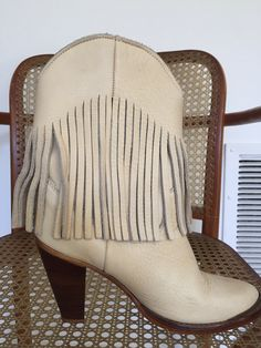 A personal favorite from my Etsy shop https://www.etsy.com/listing/598334524/womens-vintage-fringed-boots-western