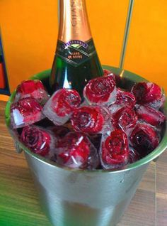 Rose Ice Cubes: For a truly romantic evening, whether it's for Valentine's Day or an anniversary, show your love with this wine bucket filled with roses encased in ice. They'll melt any heart.  Love this for a centerpiece idea in a LARGE clear container.