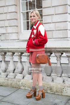 Fashion Blogger <a gi-track='captionPersonalityLinkClicked' href=/galleries/search?phrase=Pandora+Sykes&family=editorial&specificpeople=9471843 ng-click='$event.stopPropagation()'>Pandora Sykes</a> wears a vintage Varsity jacket, Gucci bag, AG Alex Chung dress and Orla Kiely shoes. on day 1 of London Collections: Women on February 20, 2015 in London, England.