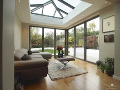 Contemporary aluminium orangery in Radlett by Kingsholme Conservatories Orangerie Extension, Conservatory Extension, Garden Room Extensions, House Extensions, Open Plan Kitchen Living Room, Open Plan Living, House Extension Design, House Design, Small Space Interior Design