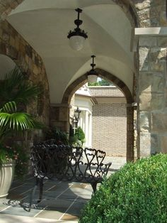 Spitzmiller and Norris - Architect - Atlanta - Tudor - Brick Columns - Brick  Floor - Metal Furniture - Arch - Lights - Dangling Lights - Outdoor Room - Bench - Neutrals - White - Plants