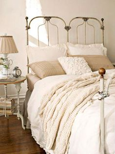 Find cozy bedroom decorating ideas, like bedding ideas, wall decor, bed frames, and bedroom furniture. These cozy bedroom ideas will make you want to stay in bed all day. Cream And White Bedroom, Cream Bedrooms, White Bedroom Design, Cozy Bedroom, Master Bedroom, Bedroom Decor, Beige Bedroom Furniture, Wall Decor, Warm Paint Colors
