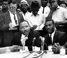 The Rev. Fred L. Shuttlesworth (seated right), who was bombed, beaten and repeatedly arrested in the fight for civil rights. Seen here with Dr. Martin Luther King, Jr. (AP Photo)