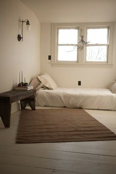 This is unrealistic due to the ridiculous amount of STUFF I have, but I really would love this minimalist bedroom.