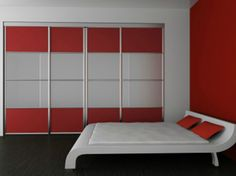 Red and white sliding doors from The Closet Builder.