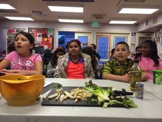 All prepped and ready to go, these kids are learning about WHY lettuce is good for them before they cook