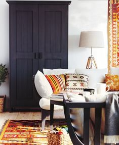 mix of deep charcoal grey, oranges, textiles, wood floors, light