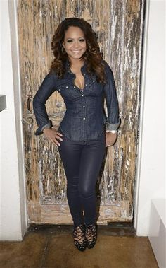 Christina Milian poses at the Colgate Optic White Beauty Bar in celebration of Golden Globes weekend in Los Angeles on Jan. 11, 2014. Other stars in attendance at the chic beauty and gifting event presented by Sexy Hair included Lisa Rinna, Jessica Szohr, Louise Roe, Keke Palmer and Cassie Scerbo.