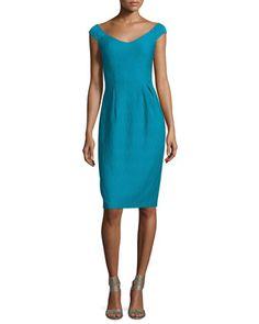 Nanette Lepore textured dress. Off-the-shoulder V neckline at front and back. Cap sleeves. Seam across the natural waist. Sheath silhouette. Even hem with center back vent. Hidden back zip. Nylon/span