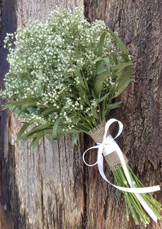 A simply lovely dried babys breath bouquet with your choice of wrap in combinations of satin ribbon colors, up-cycled coffee bag burlap, and sisal twine. This all natural dried bouquet was inspired by a fabulous bride and will make a wonderful keepsake after the wedding. Approximate