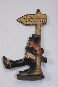 Vintage Cast Iron Figural Bourbon Street New Orleans LA Man Hanging on Sign