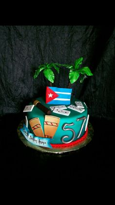 My husband's birthday cake...Old Cuban recipe...vanilla cake with guava paste in the middle. fondant top.  Dale!!!