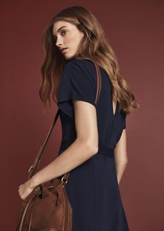 Surprise -- Ann Taylor's navy blue midi dress is detailed with a keyhole back.