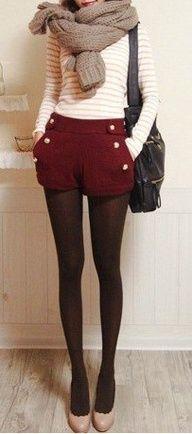 maroon waist-high shorts, cream sweater and tights.