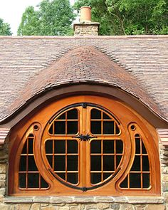 """""""butterfly window"""" // An avid collector of J.R.R. Tolkien books, manuscripts and artifacts built his own Hobbit habitat."""