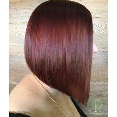 bright vibrant red violet sharp angled bob