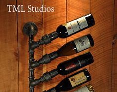 I appreciate you taking the time to view my products! They are handcrafted using pine and galvanized pipes. The pipes come in a rustic, natural grey color, which comes standard on all of my products. For an extra fee, I can stain the wood to a color of your choice, and/or paint the pipes to a color of your choice. Let me know in a message before purchase so that I can add in the fee. Since items are handmade, allow roughly a week for completion until order can be shipped out. Under certain…