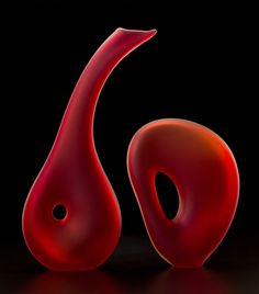 The velvet soft translucent scarlet color of the Melange Series 10 by Bernard Katz heightens the unity between the pair of hand blown glass forms.