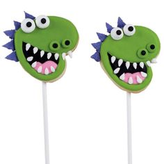 Dragon Cookie Pops - Goofy lizards on sticks will start kids' hearts a pumping. Use a Heart Cookie Cutter to create cookie heads; add dragon details with flowed-in and piped-on color flow icings.