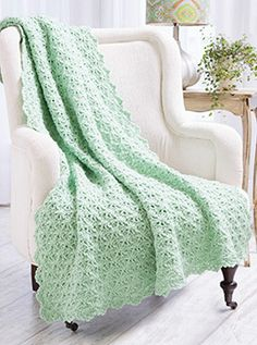 Flirty Fans Afghan/combines pretty lacy shells with back post stitches to create a stunning reversible fabric!
