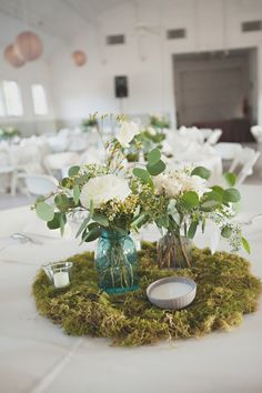 another option, we could do a moss base, and 3 small vases on top with either green, orange, hot pink or soft yellow blooms