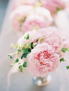 [by Clary Pfeiffer] centerpieces pink- if done with pink garden roses, would be much less expensive than peonies