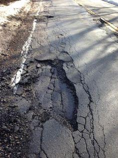 POTHOLE OF THE DAY: Nayatt Rd. near RISD Farm. Actually a whole road full of #RIpothole. @RIDOTnews take note.