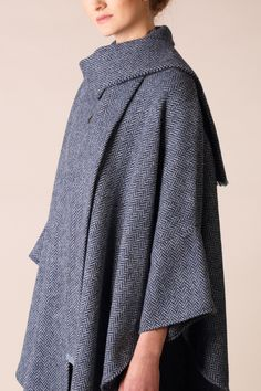 Designed and woven in Ardara, County Donegal, our Roisin cape has been woven in a classic herringbone pattern. The flecks of blue and navy running through this cape give a stylish edge. #donegaltweed #cape #wool #tweed #irishfashion #wearingirish Irish Fashion, Wool Cape, Capes For Women, Donegal, Herringbone Pattern, Fit S, Wool Sweaters, Timeless Design, One Size Fits All