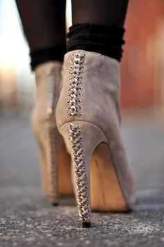 Vince Camuto, Cannon Fawn Booties ---- Chain and lace-up detail.