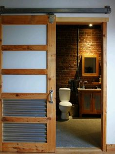 Mens room: above garage this would be great I love the brick wall and sliding barn door.