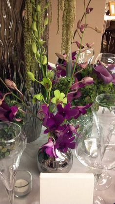Hard Rock Nashville's Modern Watercolor Theme Tablescape Orchids in green and purple add another layer and texture to the table.