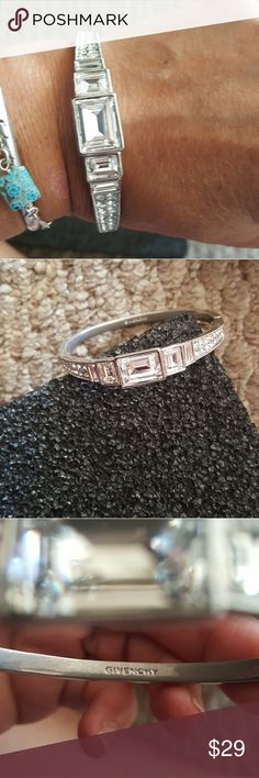 Givenchy bangle Beautiful givenchy crystal rhinestone bangle, in good condition no missing stones. The inside shows it has been loved. givenchy Jewelry Bracelets