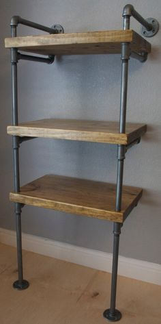 Industrial Media Stand, Pipe Shelving Unit- Media storage, Industrial Furniture, Industrial bookshelf, bookcase w/optional reclaimed wood by IndustrialEnvy on Etsy https://www.etsy.com/listing/190183104/industrial-media-stand-pipe-shelving