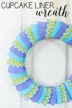 A simple craft using cupcake liners to make a bright, fun colored wreath! Use different colors and patterns for seasons, holidays, or birthday celebrations!