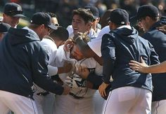 Detroit Tigers shortstop Alex Gonzalez who hit the walk off single scoring Tyler Collins in the bottom of the ninth inning is mobbed by his teammates after the Tigers defeated the Kansas City Royals 4-3 in the Tigers home opener.