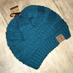 Slouchy Knit Beanie -TEAL Keep warm while looking ADORABLE! Super cute beanie with C.C label on it. Adorable, slouchy, thick knit and super soft.  This listing is for the TEAL beanie. Price is firm. Bundles of 2 or more save 15%. Lots of colors available. Check other listings❄️ Accessories Hats