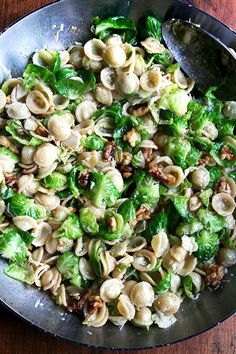 In this super-fast pasta dish, a simple brown butter sauce dresses orecchiette, Brussels sprouts, toasted walnuts and Pecorino. While any pasta shape will work, orecchiette, which shares the same shape as the Brussels sprout leaves, is particularly fun.