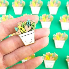 This happy heart and leaf potted plant pin is a great gift for the crazy plant lady we all know or any house plant or succulent lover in general. These make great little gifts and stocking fillers or even as an addition to your very own pin collection. Please note that due to differences in computer monitors, colours may vary from that on the screen due to differences in computer monitor settings. Made from: Each pin is gold plated and is filled with hard enamel. Each pin comes on its own…