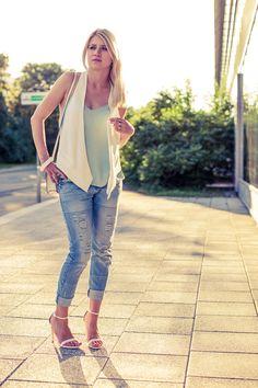 White vest, mint top, boyfriend jeans outfit