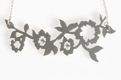 Acrylic Flower Vine Necklace- Silver coloured acrylic flower vine hangs horizontally from a sterling silver link chain. Acrylic Flowers, Laser Cut Acrylic, Flowering Vines, Floral Necklace, Silver Necklaces, Jewelry Collection, Indigo, Jewellery, Sterling Silver