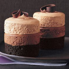 Triple-Chocolate Mousse Cake Recipe -- The dark-chocolate cake at the base is baked in ramekins. Two layers of plush, pillowy mousse -- bittersweet and milk chocolates -- are piped on top and capped with semisweet chocolate curls.